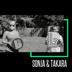 Image of Big Sister Sonja standing six feet apart from Little Sister Takara. They are both holding Big Brother Big Sister's Bs and wearing masks.