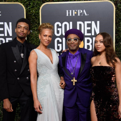 Image of the Lee family on the Golden Globes red carpet.