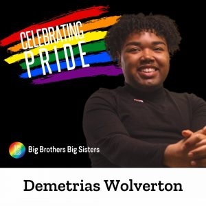 """Portrait of Demetrias Wolverton on the right with """"Celebrating Pride"""" in front of rainbow striped paint brush strokes. On the bottom left, the BBBS Pride logo and a white band at the very bottom with """"Demetrias Wolverton"""" in black text."""